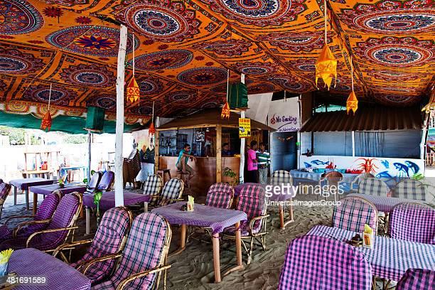 Tables and chairs at a restaurant Morning Star Arambol Beach Arambol North Goa Goa India