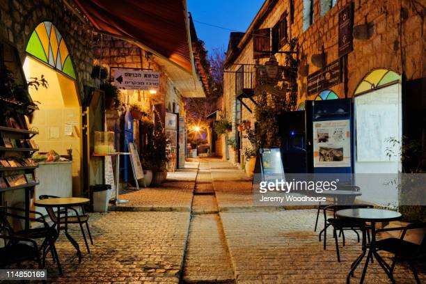 tables and chairs at cafe at night - safed stock photos and pictures