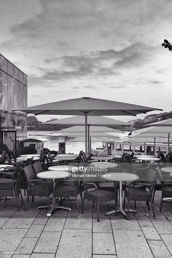 Tables And Chairs By River : Foto stock