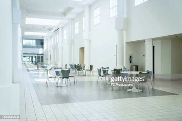 Tables and chairs in empty lobby