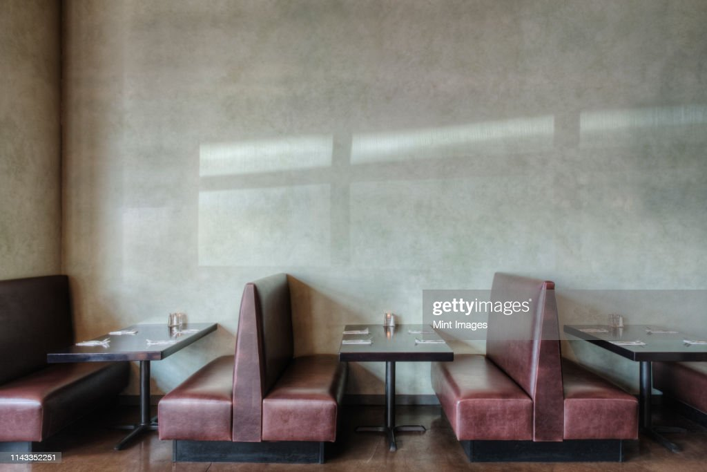 Tables and chairs in empty restaurant : Stock Photo