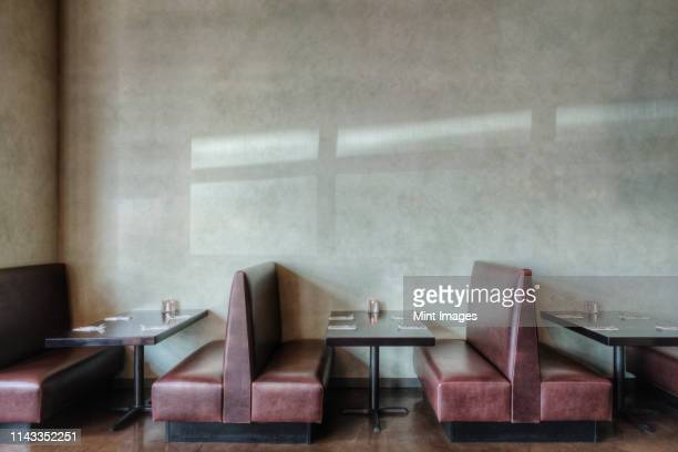 tables and chairs in empty restaurant - restaurant stock pictures, royalty-free photos & images