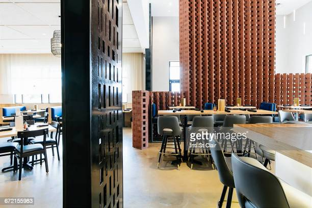 Tables and chairs in modern bar and restaurant