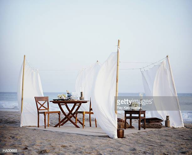 Tables and chairs on beach,  champagne in bowl with ice