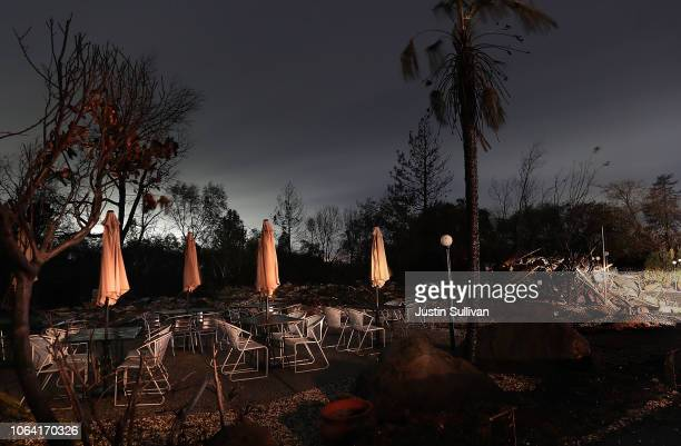 Tables and chairs remain next to a restaurant that was destroyed by the Camp Fire on November 21 2018 in Paradise California Fueled by high winds and...