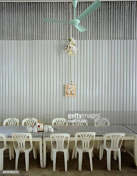 Tables and chairs set with chop sticks and bowls at the Perfume Pagoda
