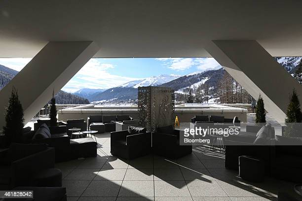 Tables and chairs stand on an outdoor terrace at the InterContinental hotel Davos operated by InterContinental Hotels Group Plc ahead of the World...