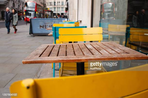 Tables and chairs stand vacant outside a branch of Italian food chain Pizza Express on Haymarket in London England on March 17 2020 Hospitality...