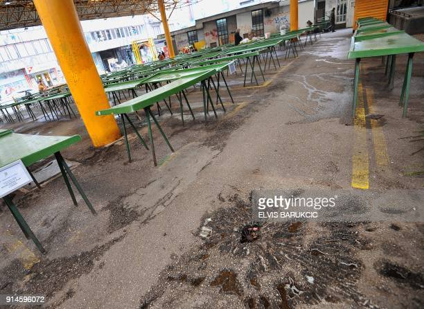 Tables are empty at Sarajevo's main green market 'Markale' on February 5 2018 after it remained closed in commemoration of the 24th anniversary since...