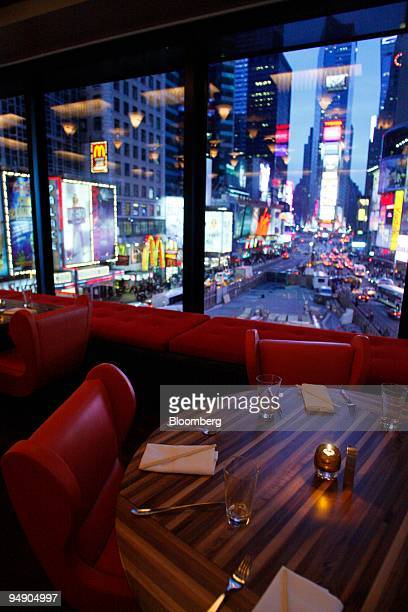Tables are set for dinner service at Chop Suey overlooking Time Square in New York US on Saturday Jan 26 2008 Irony might be the next logical...