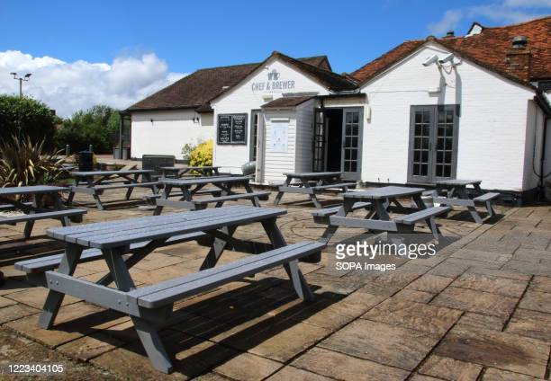 Tables arranged to maintain social distance in the garden of one of the pubs in the scheme. All Greene Kings pubs will follow a new set of Pub Safe...