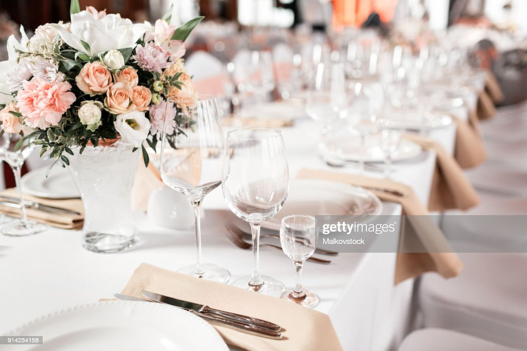 Tables set for an event party or wedding reception. luxury elegant table setting dinner in a restaurant. glasses and dishes. : Stock Photo
