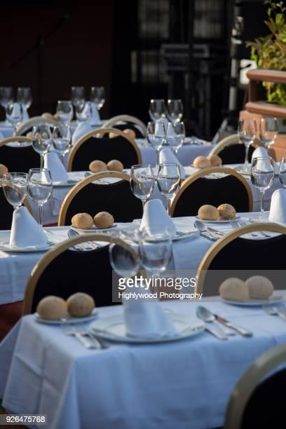 tables set for celebration on a rooftop in granada - highlywood - fotografias e filmes do acervo