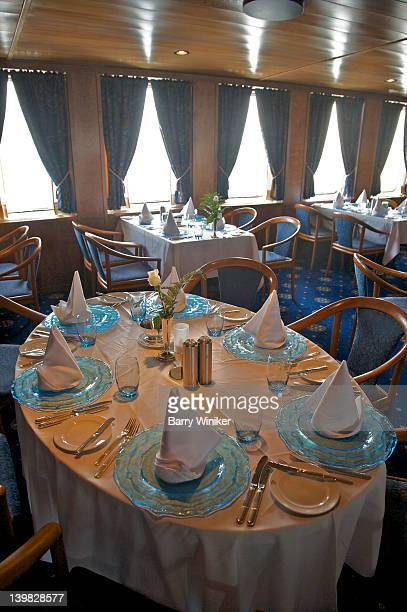 Tables set for dinner in restaurant aboard Wind Spirit of Windstar Cruises