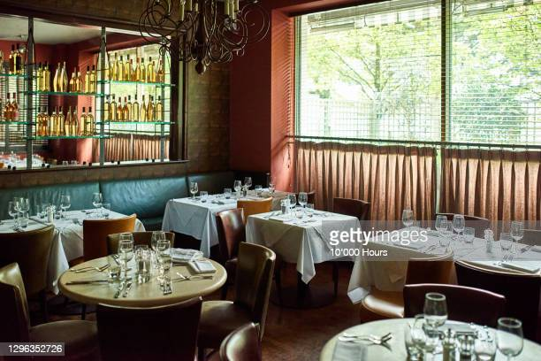 tables set in restaurant - indoors stock pictures, royalty-free photos & images