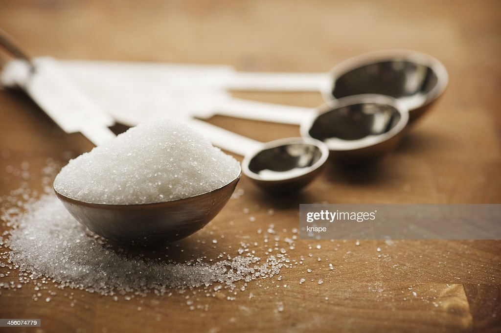 Tablespoon filled with granulated sugar : Stock Photo