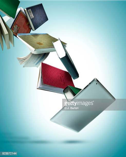 Tablet and books on blue background