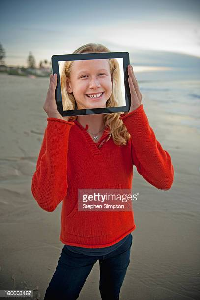 tablet computer self-portrait on the beach