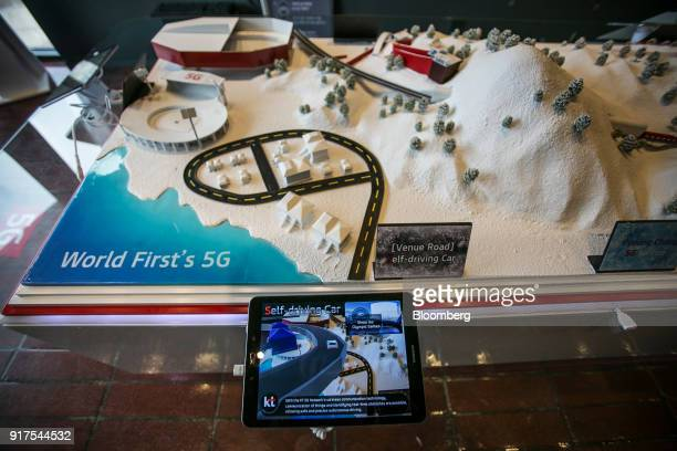 A tablet computer stands next to a diorama equipped with mixed reality technology displaying various venues of the 2018 PyeongChang Winter Olympic...