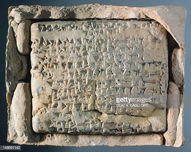 Tablet engraved in cuneiform characters enclosed in an envelope with legal text relating to inheritance Artefact from El Quito Syria Assyrian...
