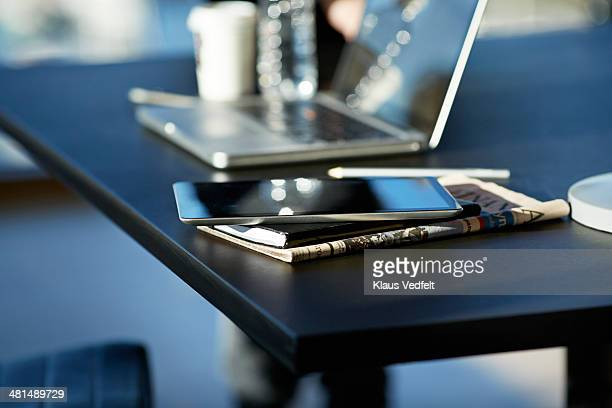 tablet on top of notebook and newspaper - publication stock pictures, royalty-free photos & images