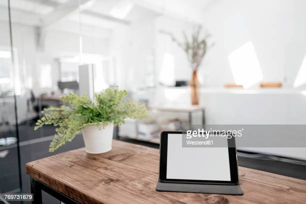 Tablet on wooden table in office