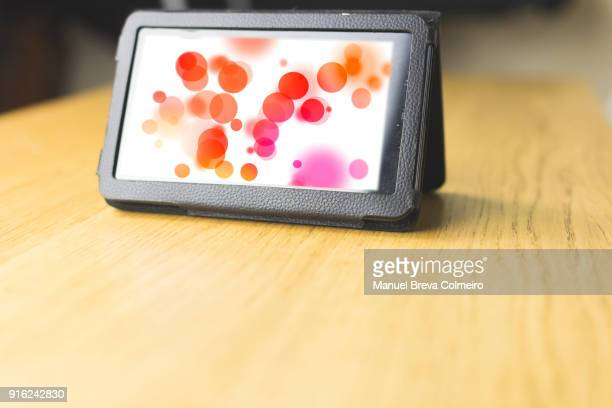 tablet over the table - screen saver stock photos and pictures