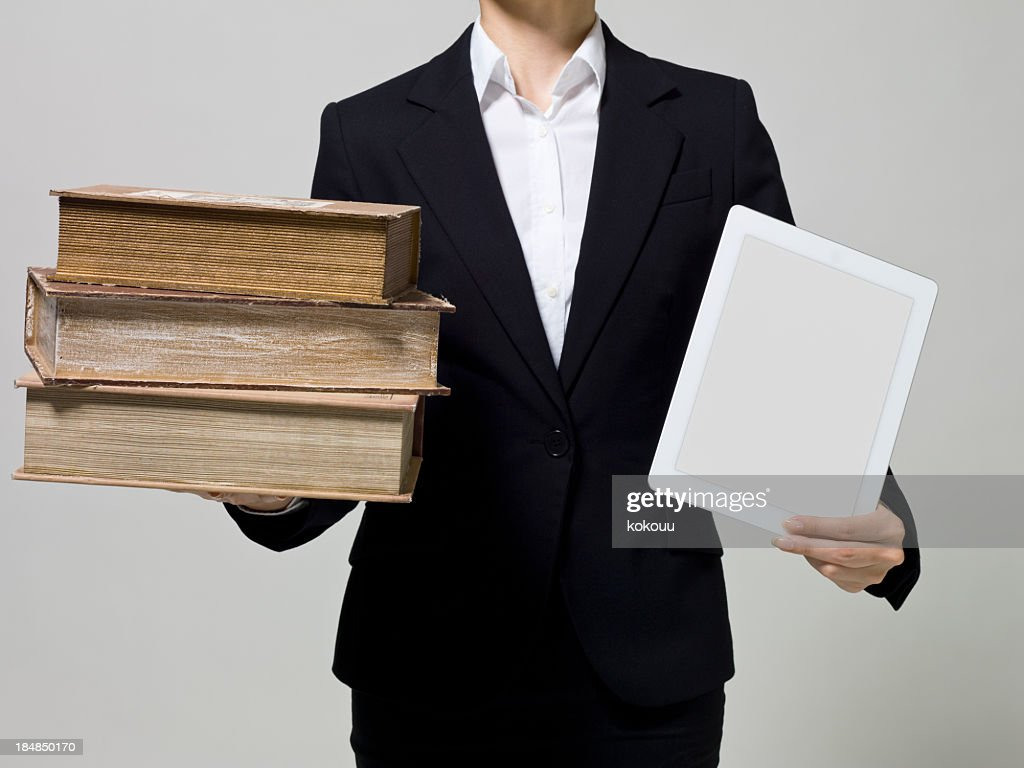 Tablet PC and old books : Stock Photo
