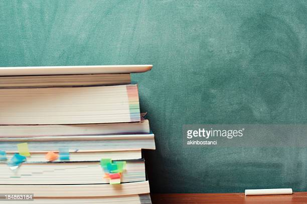 Tablet PC, books and blackboard