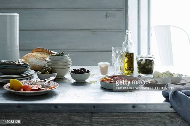 Tablet set with olives, meat and cheese