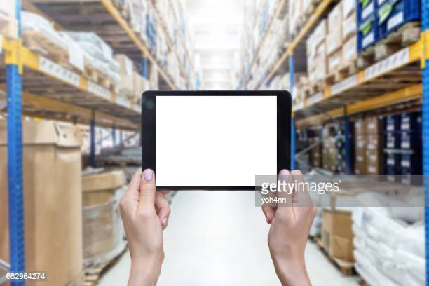 Tablet & white screen & warehouse