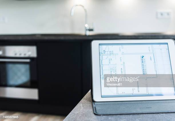Tablet with floor plan on kitchen counter