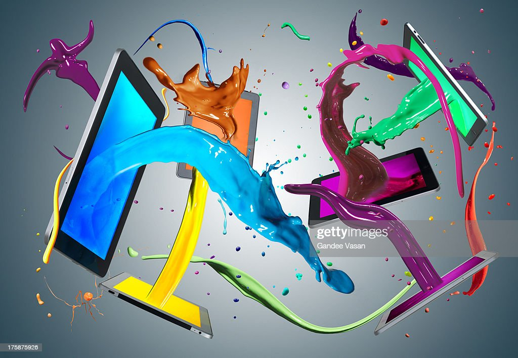 Colorful paint coming out of tablet computers