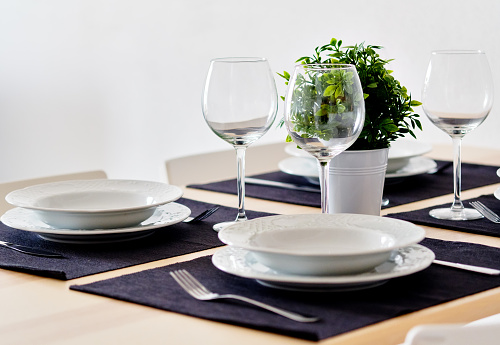 Tableware and empty wine glasses ready for dinner 1223794239