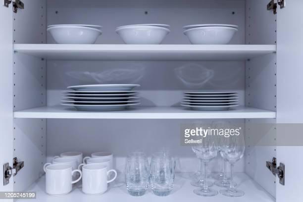 tablewares in cupboard - キャビネット ストックフォトと画像
