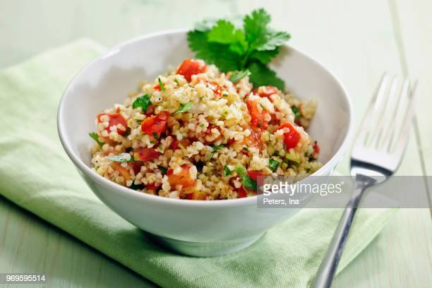 tablouleh (bulgur salad with tomatoes, mint and parsley, lebanon) - tabbouleh stock pictures, royalty-free photos & images