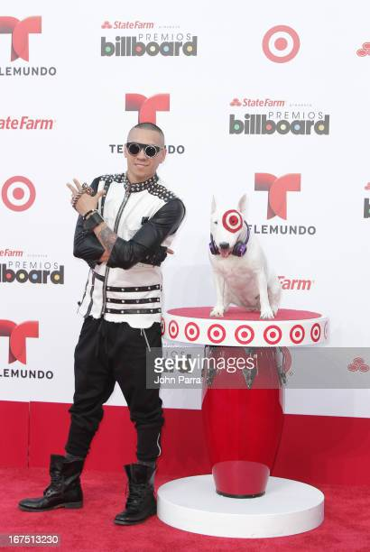 Taboo celebrates with Bullseye Target's Beloved Bull Terrier Mascot at the 2013 Billboard Latin Music Awards at BankUnited Center on April 25 2013 in...