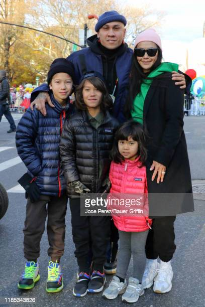 Taboo of The Black Eyed Peas his wife Jaymie Dizon and their children Jimmy Journey and Jett attend the 93rd Annual Macy's Thanksgiving Day Parade on...