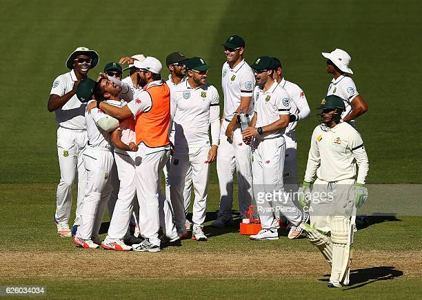 Tabraiz Shamsi of South Africa celebrates after taking the wicket of Usman Khawaja of Australia during day four of the Third Test match between...