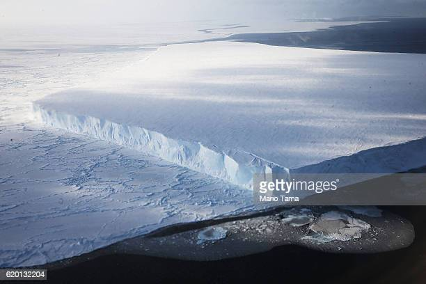 A tabular iceberg floats near the coast of West Antarctica as seen from a window of a NASA Operation IceBridge airplane on October 27 2016 inflight...