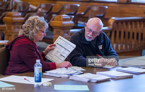 Tabulators hand count ballots on the presidential recount on December 1 2016 at the Green County Courthouse in Monroe Wisconsin Green Party candidate...