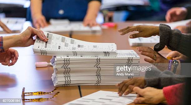 Tabulators work on recounting presidential ballots in Dane County on December 1 2016 in Madison Wisconsin Green Party candidate Jill Stein has...