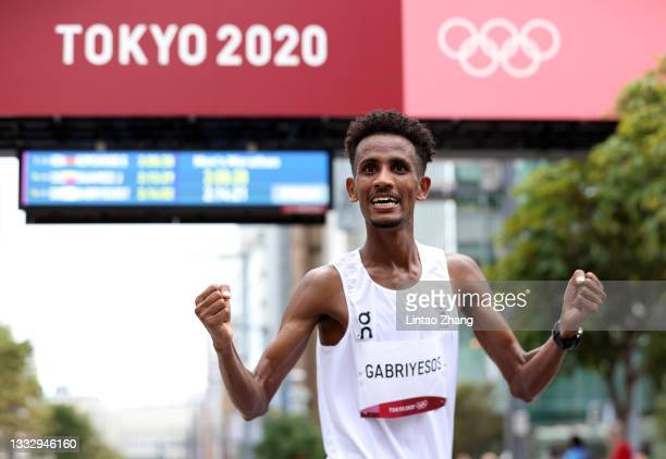 Tachlowini Gabriyesos of the Refugee Olympic Team celebrates after competing in the Men's Marathon Final on day sixteen of the Tokyo 2020 Olympic...