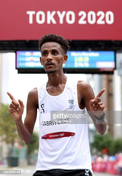 Tachlowini Gabriyesos of the Refugee Olympic Team reacts after competing in the Men's Marathon Final on day sixteen of the Tokyo 2020 Olympic Games...