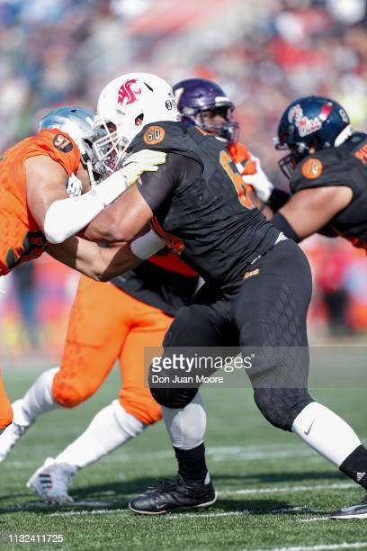 Tackle Andre Dillard of Washington State of the South Team blocks Defensive Lineman Jalen Jelks of Oregon of the South Team during the 2019 Resse's...