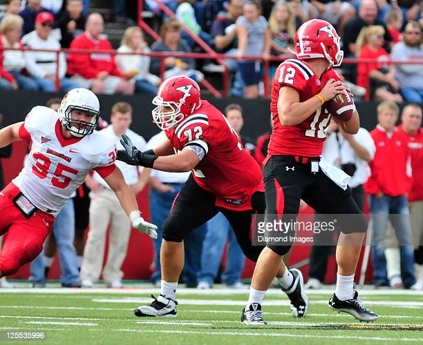 Tackle Andrew Radakovich of Youngstown State blocks defensive end Colton Underwood of Illinois State while Quarterback Kurt Hess sets up to throw...