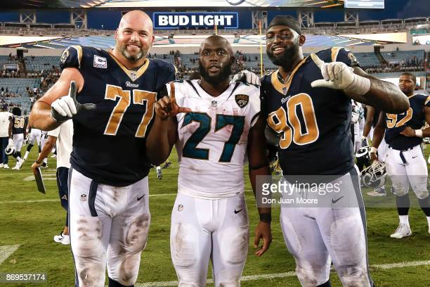 Tackle Andrew Whitworth and Defensive Tackle Michael Brockers of the Los Angeles Rams pose with Running back Leonard Fournette of the Jacksonville...