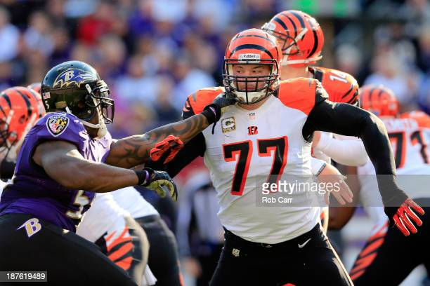 Tackle Andrew Whitworth of the Cincinnati Bengals blocks outside linebacker Terrell Suggs of the Baltimore Ravens at M&T Bank Stadium on November 10,...