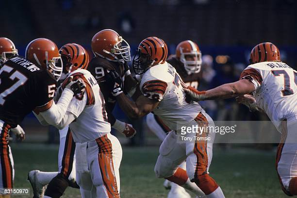 Tackle Anthony Munoz of the Cincinnati Bengals blocks a defender for the Cleveland Browns during a game on December 2 1984 at Municipal Stadium in...
