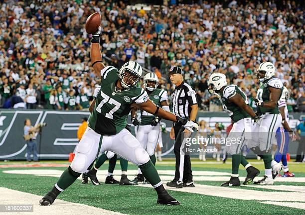 Tackle Austin Howard of the New York Jets spikes the ball after wide receiver Santonio Holmes yard touchdown catch in the 2nd half of the Jets 2720...